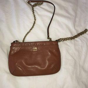 Brown cross body coach purse